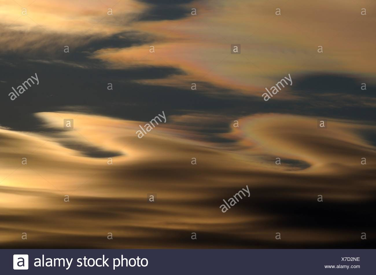 Altocumulus lenticularis clouds with rainbow colors at sunset - Stock Image