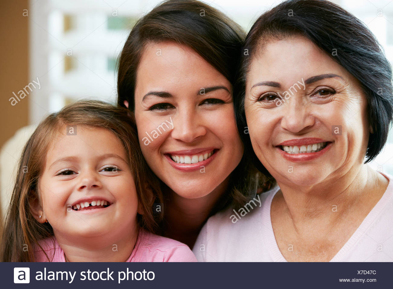 Female Members Of Multi Generation Family Relaxing At Home Together - Stock Image