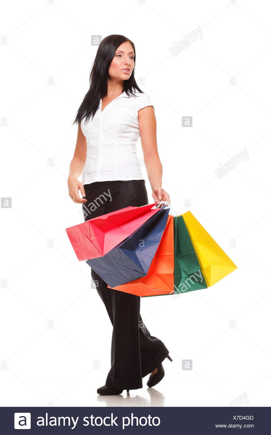 Full body portrait cheerful businesswoman holding shopping bags Isolated - Stock Image