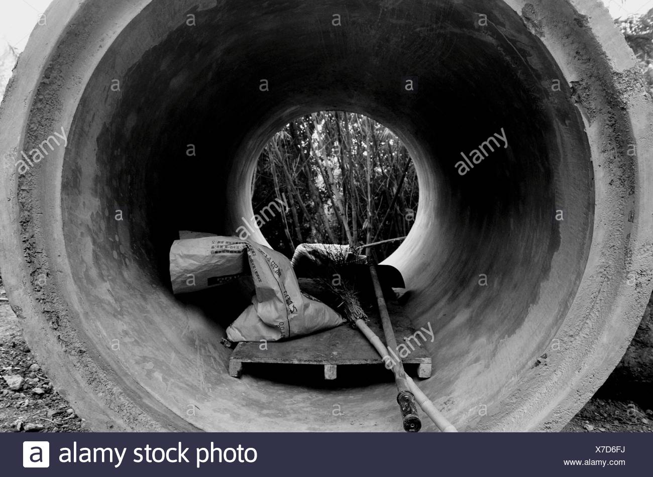 Sack And Work Tools In Cement Pipe - Stock Image