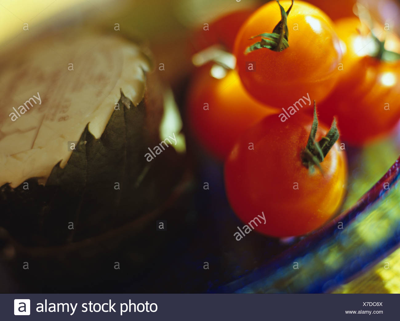 Cherry tomatoes and cheese - Stock Image