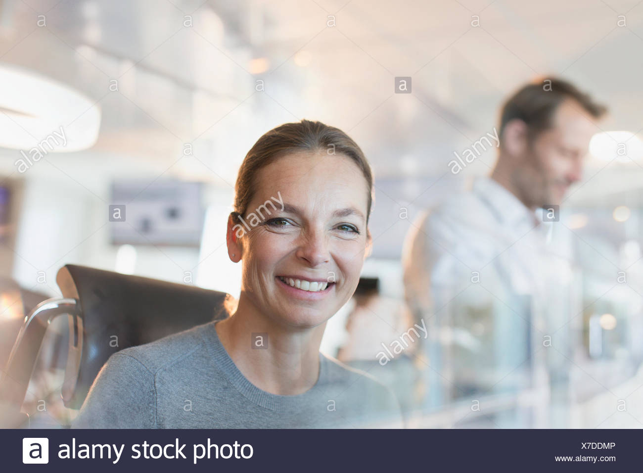 Portrait smiling businesswoman in office Stock Photo