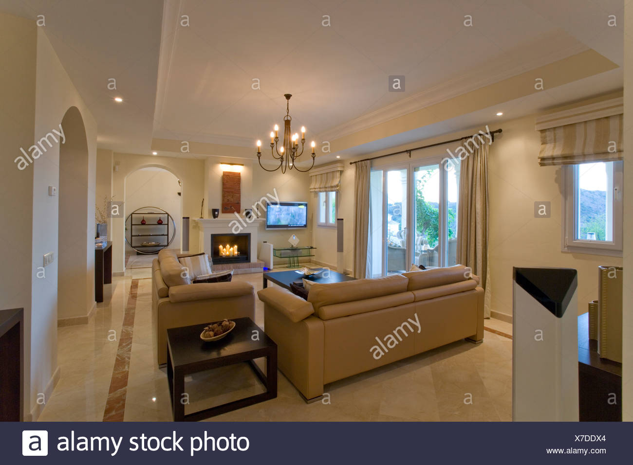 Beige Leather Sofa In Apartment Livingroom With Fireplace And Marble Floor Stock Photo Alamy