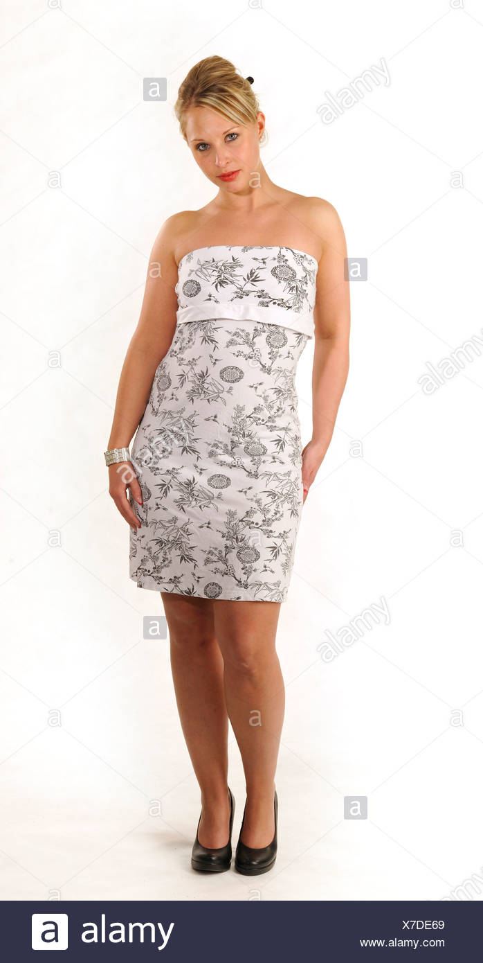 Young woman wearing a cocktail dress - Stock Image