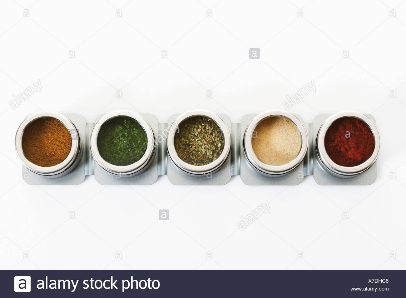 Variety of herbs and spices in box on white background - Stock Image