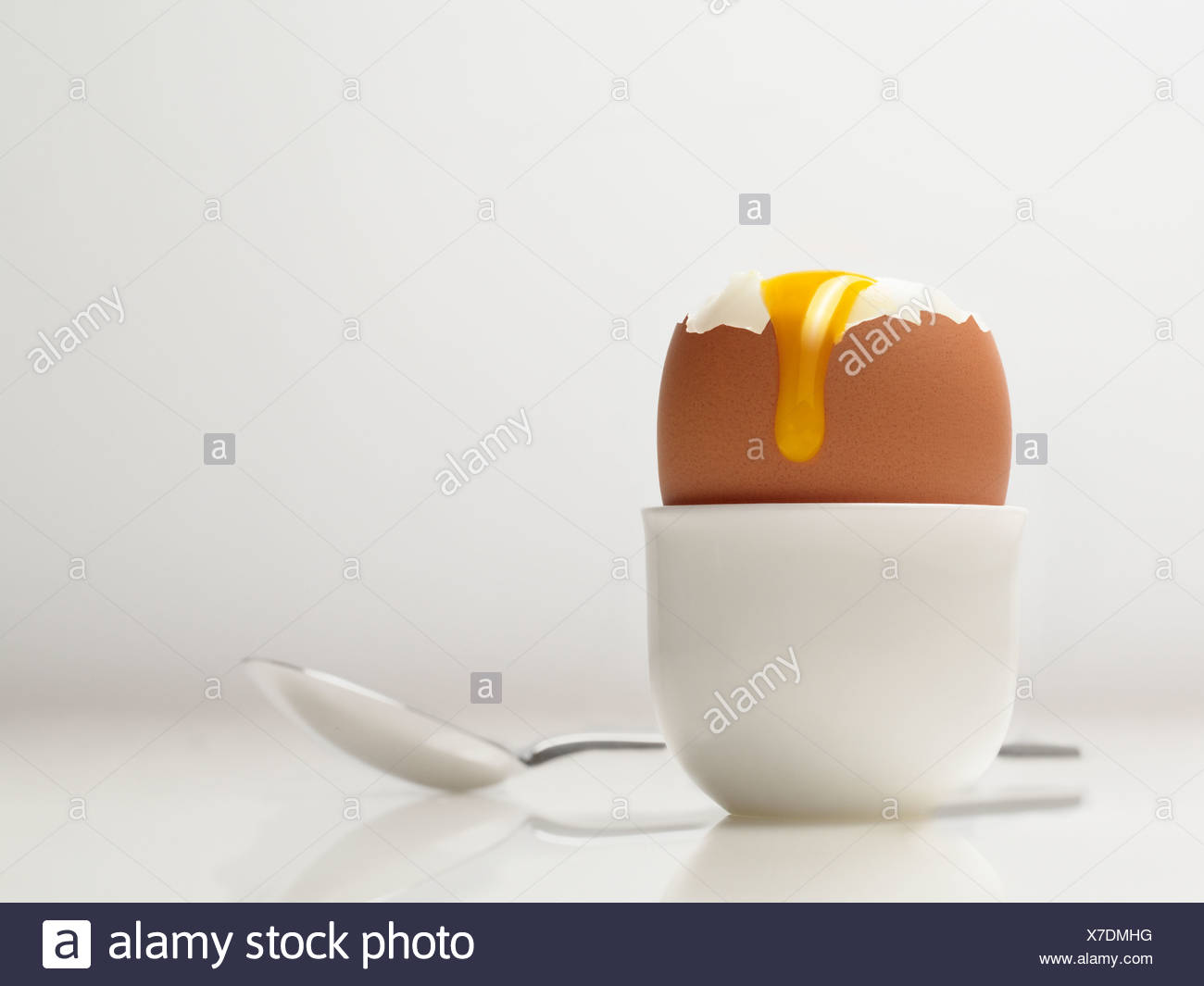 Runny Boiled Egg - Stock Image