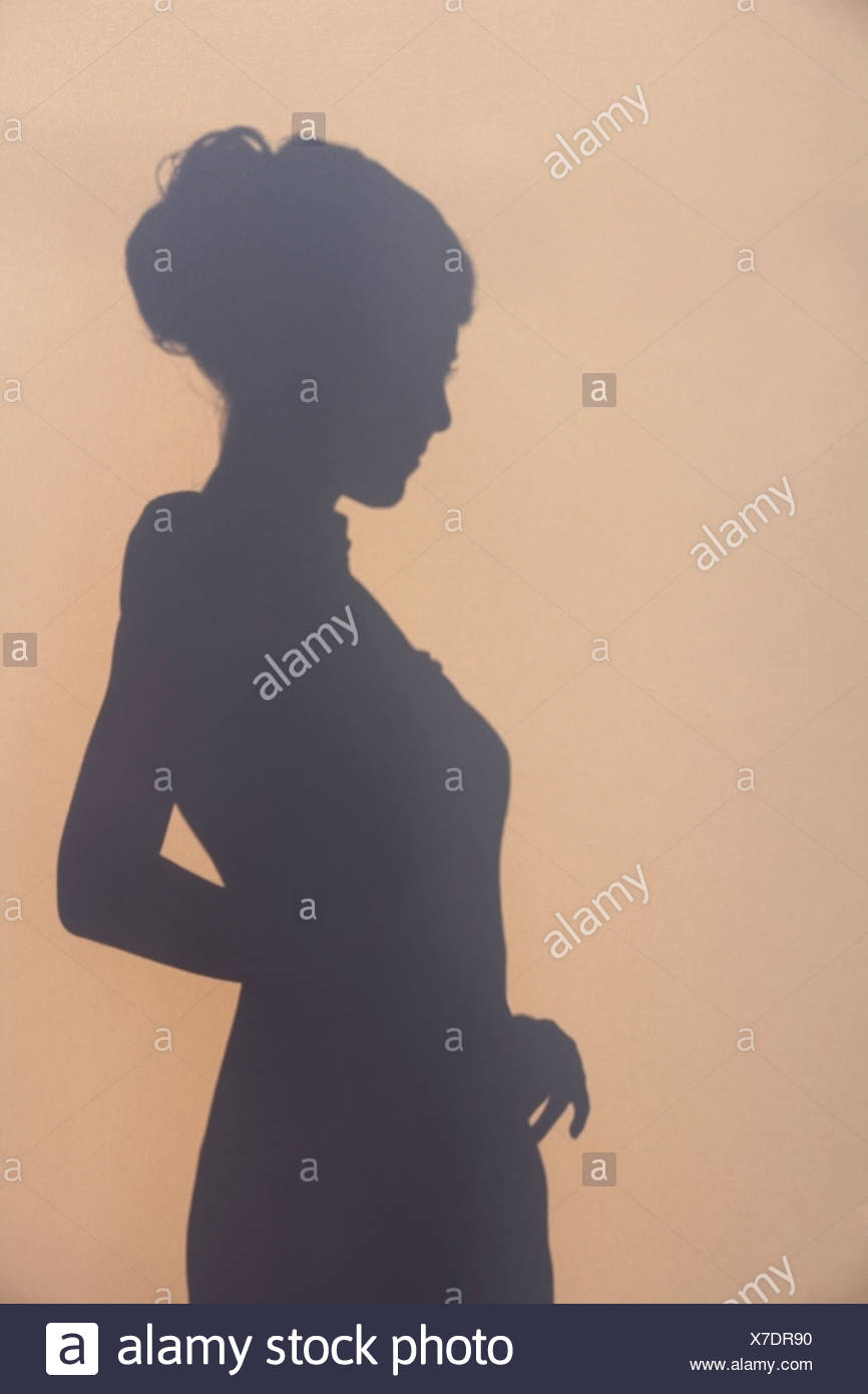 Silhouette of a young woman in 1930's Style dress - Stock Image