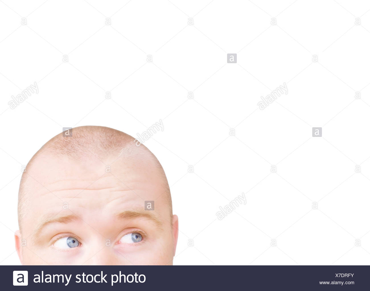 Part of a man's head looking sideways - Stock Image