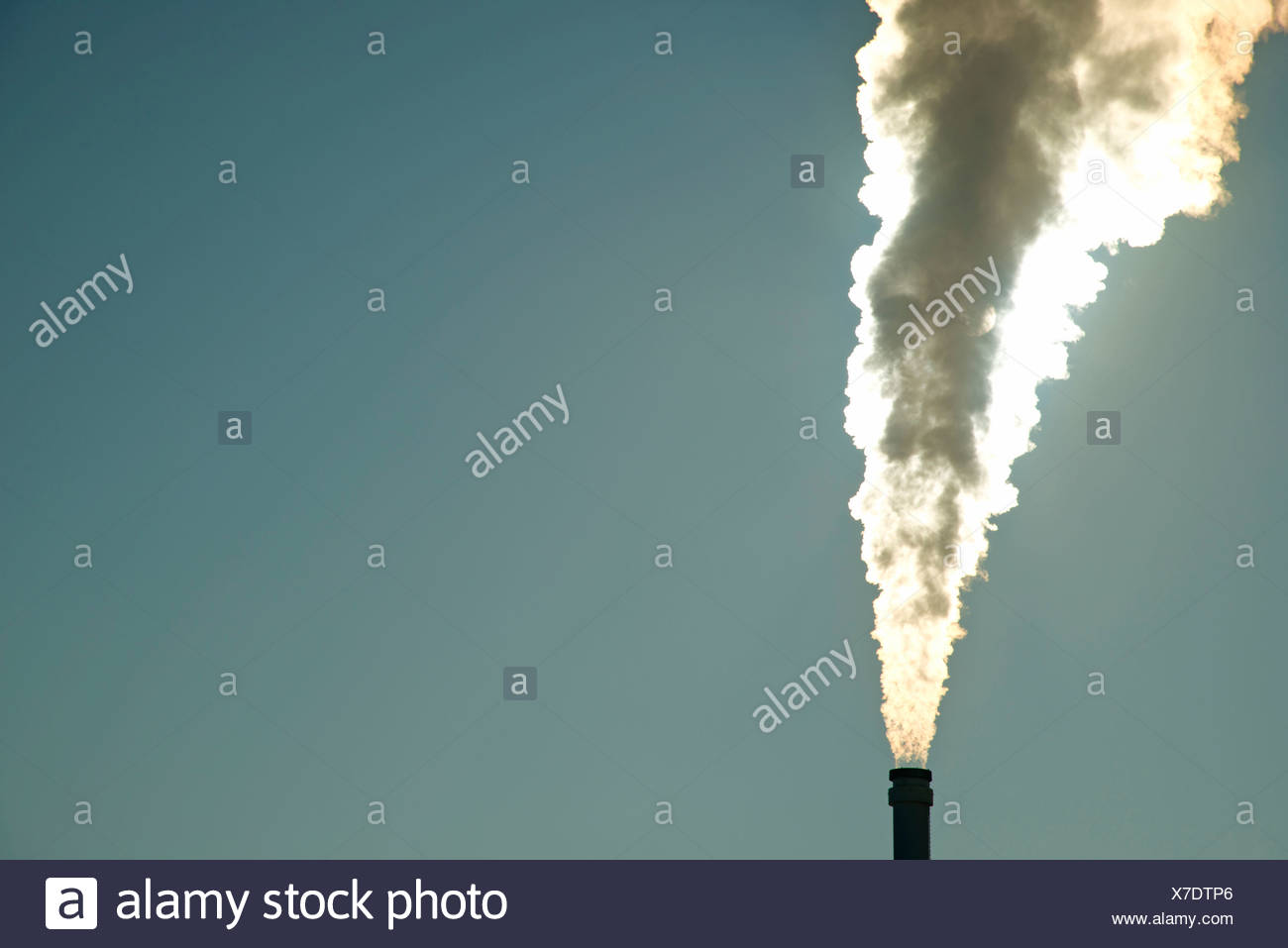 Waste gases outside FRG federal republic CO2 Germany issue emission energy energy source global warming Europe back light back - Stock Image