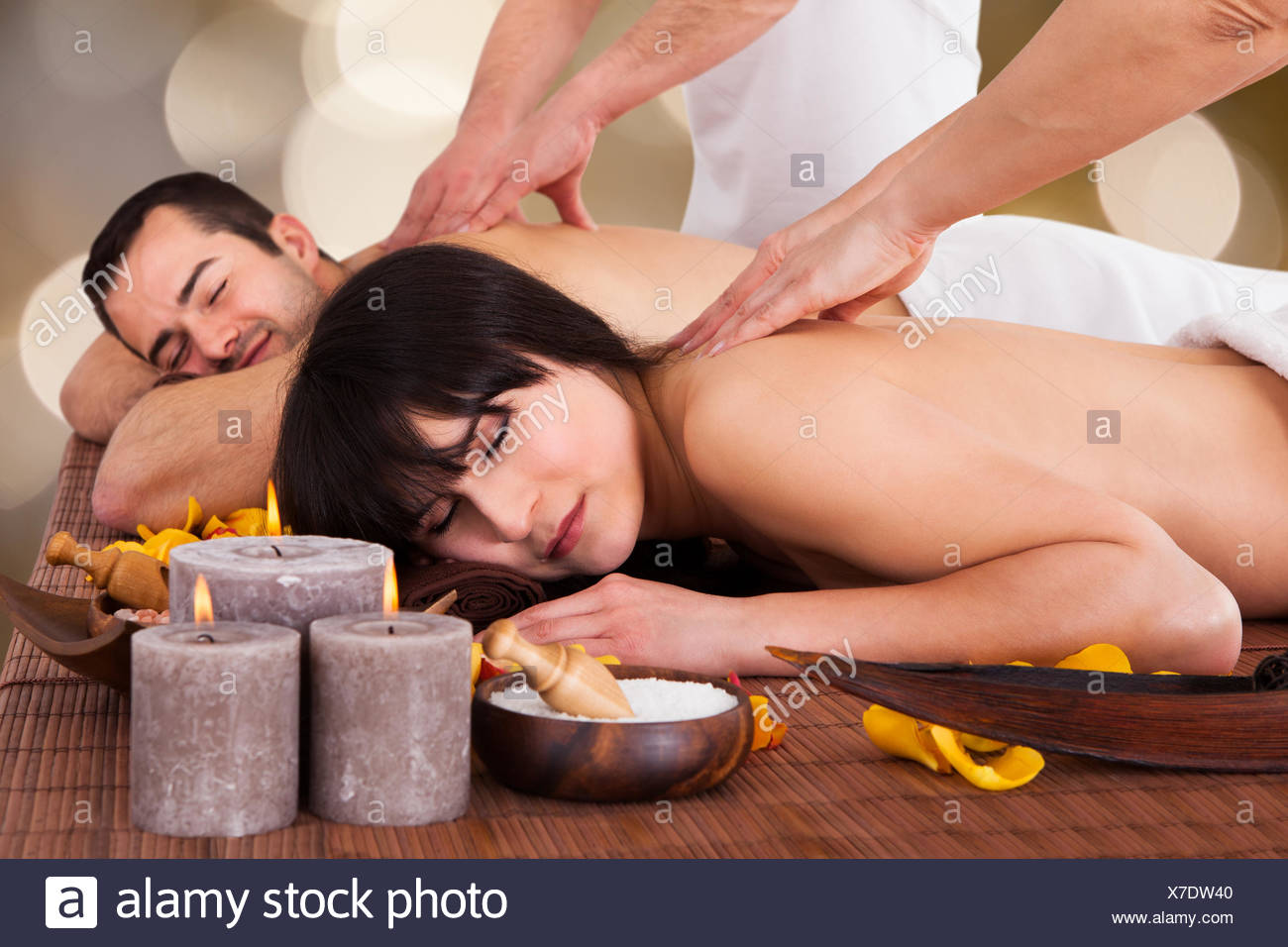 Beautiful Young Couple Enjoying Massage - Stock Image