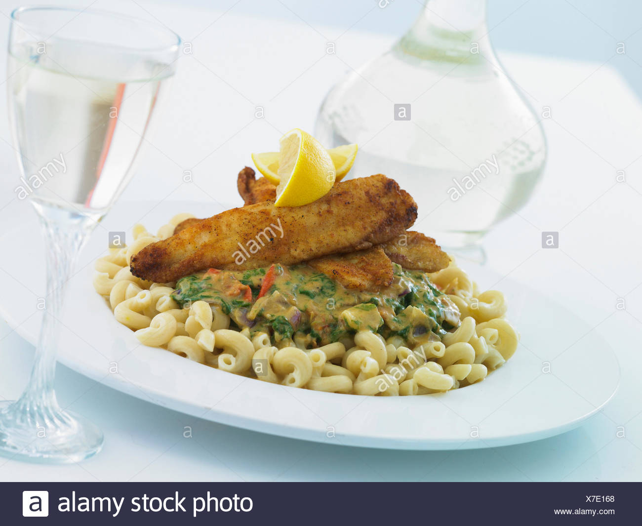 Pasta Twists With Curried Spinach And Fish - Stock Image