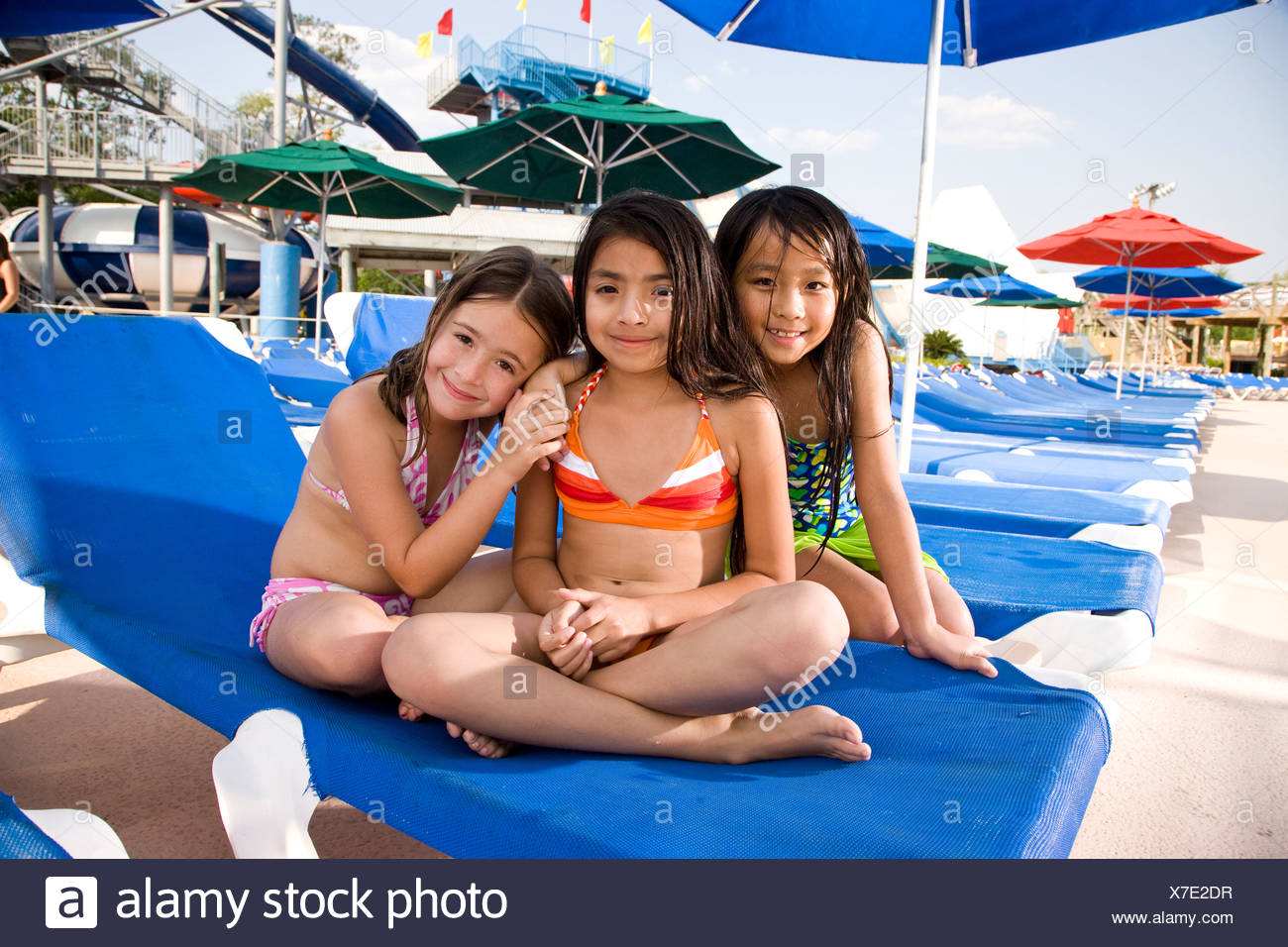 Astounding Multi Ethnic Girls In Swimsuits Sitting On Lounge Chair In Camellatalisay Diy Chair Ideas Camellatalisaycom