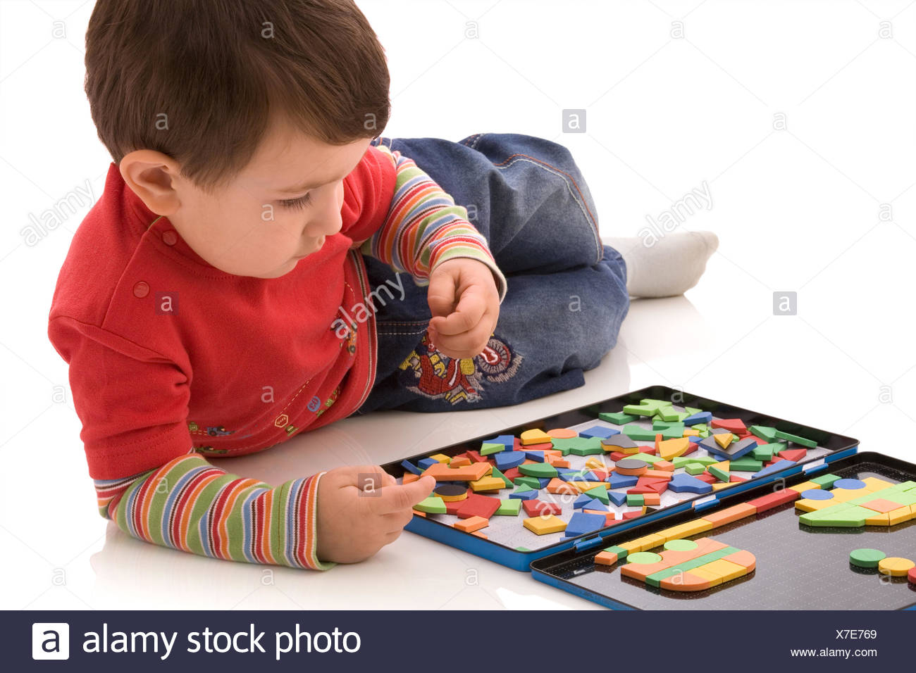 Boy plays with the magnetic designer - Stock Image