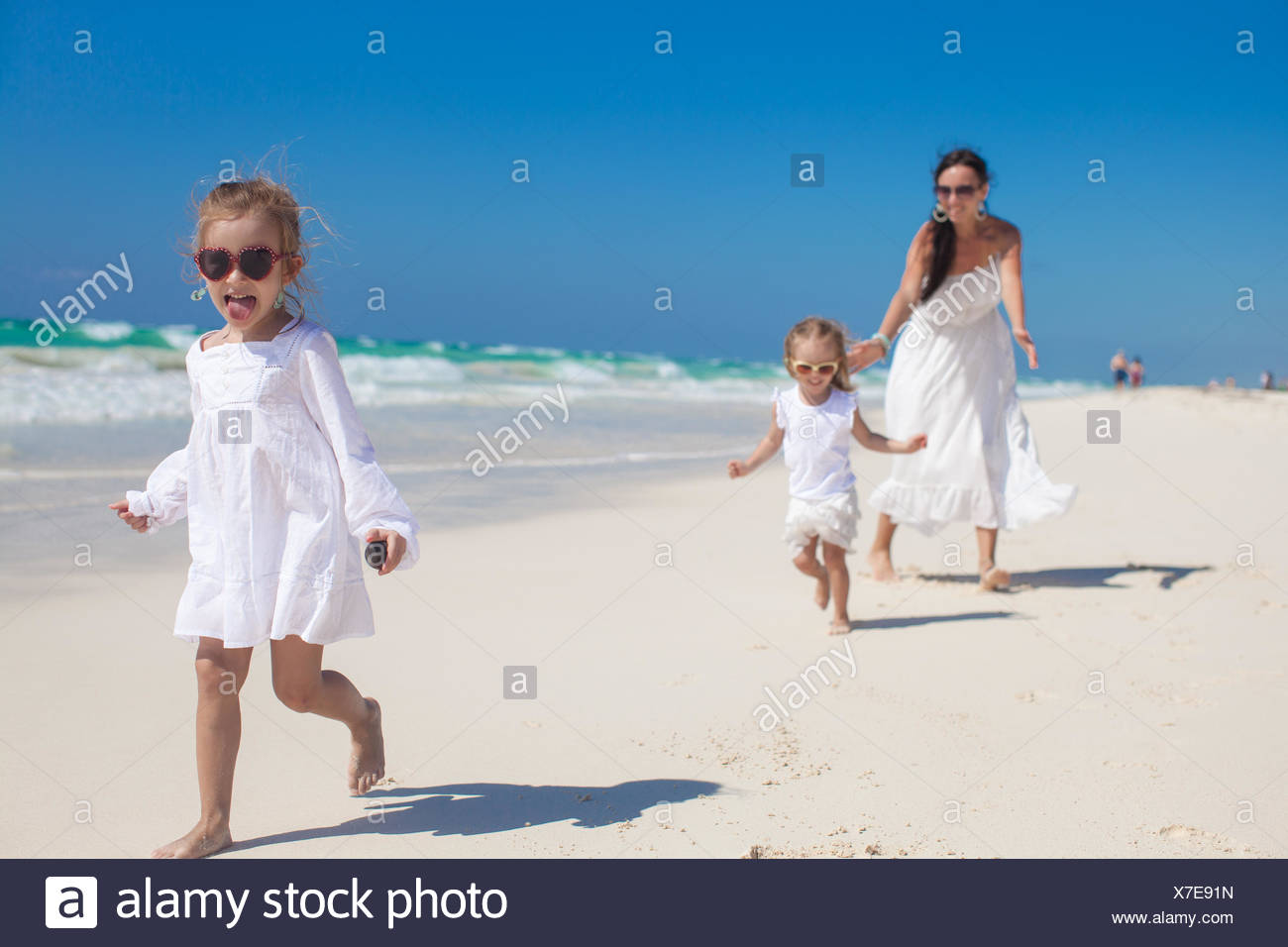 e64168f61f3e7 Young mother and her cute daughters enjoy summer vacation Stock ...