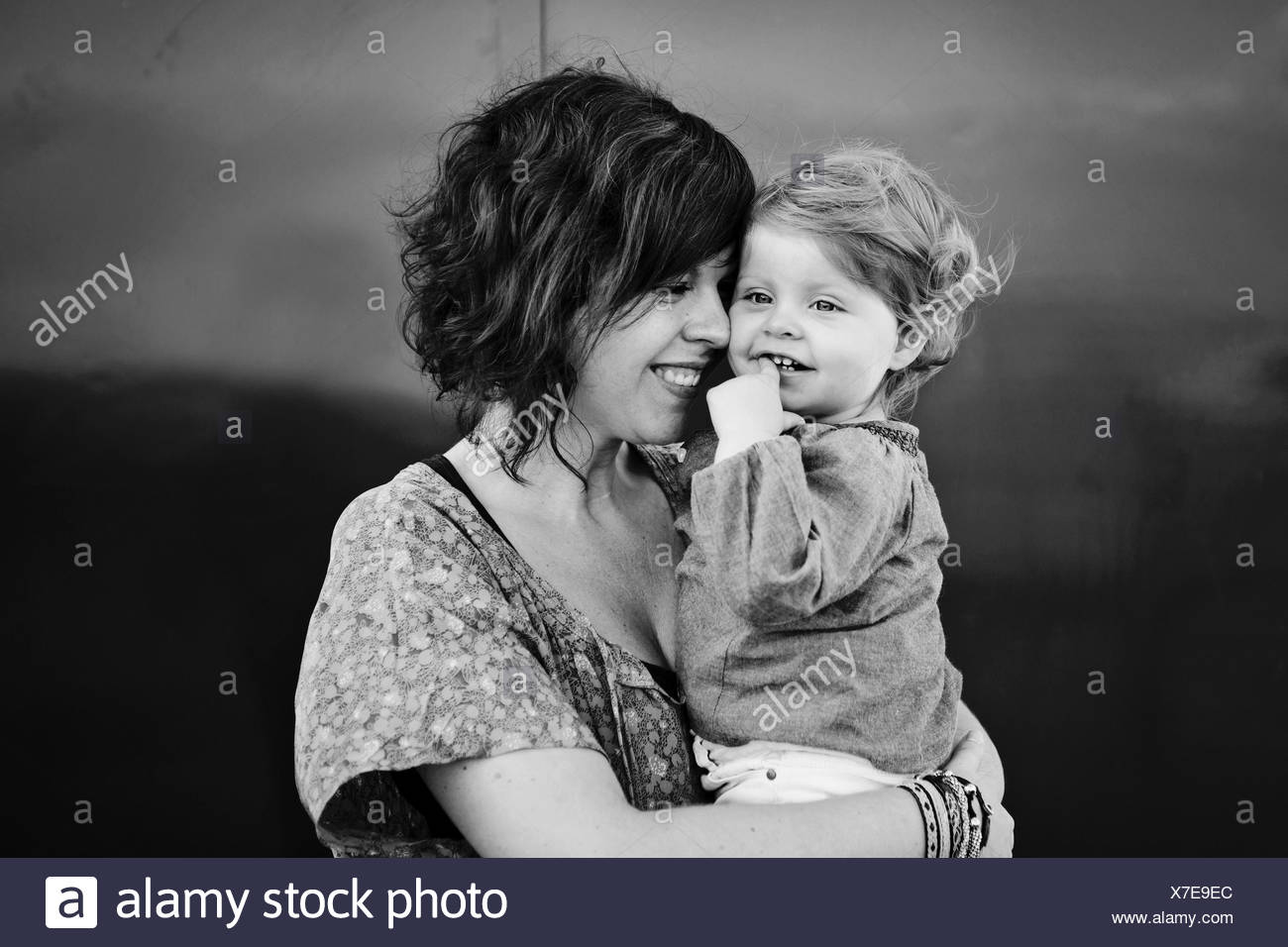Tender moment between mother and toddler girl - Stock Image