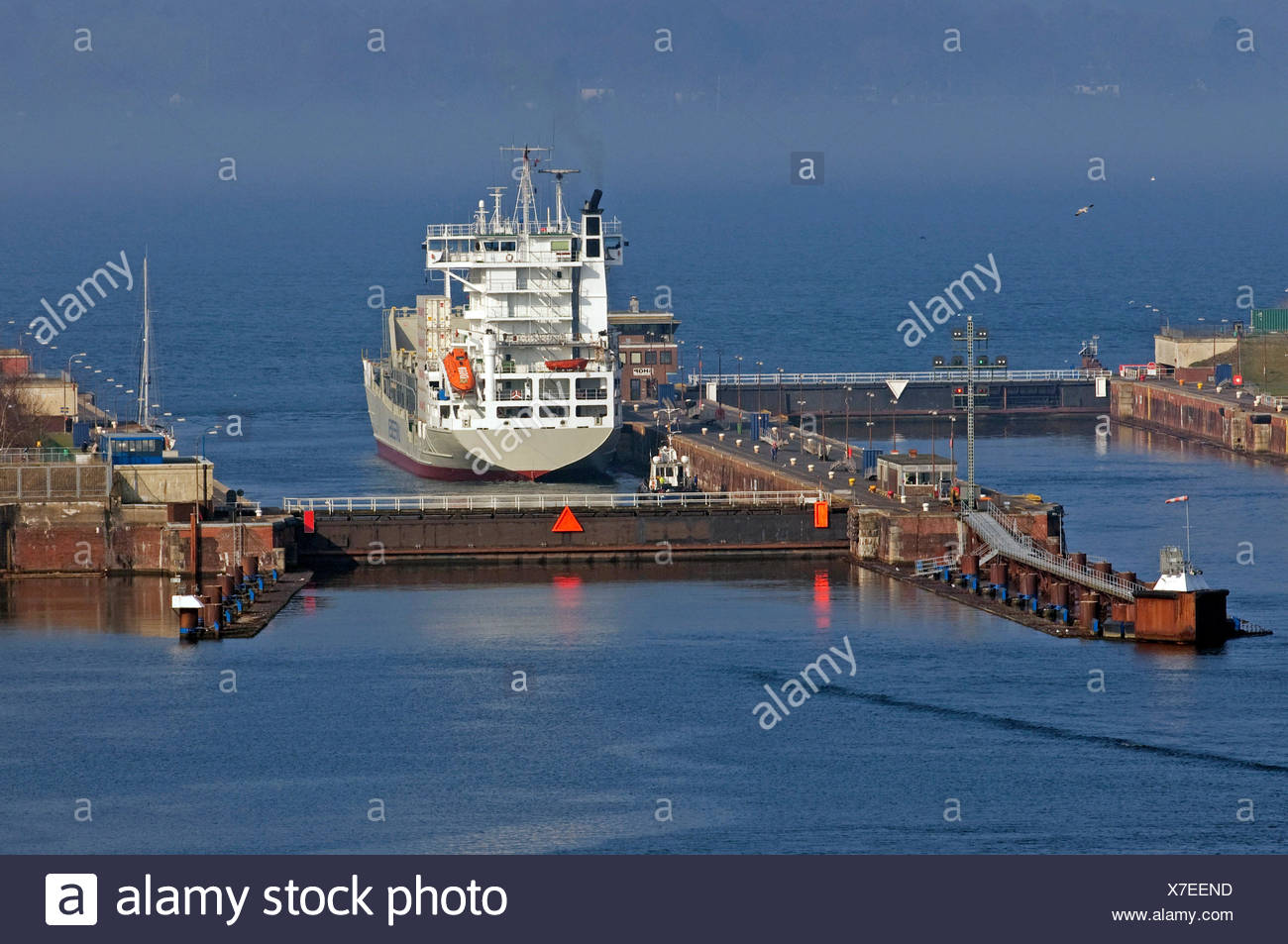 container ship container containers container ship channel water baltic sea Stock Photo