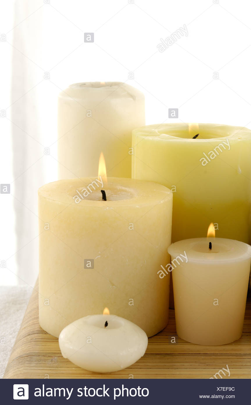 candles burning in spa - Stock Image