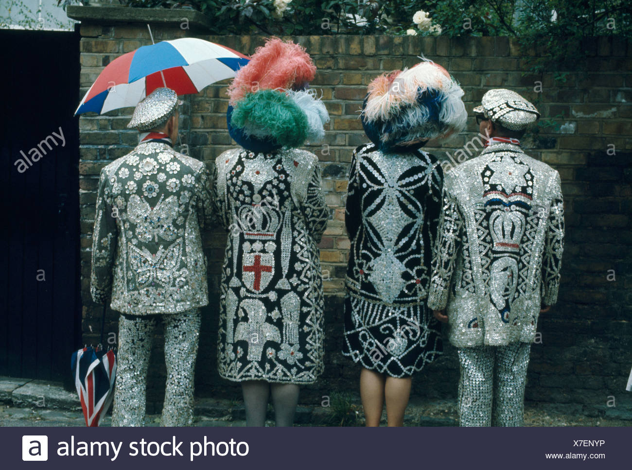 Pearly kings and queens showing the backs of their coats - Stock Image