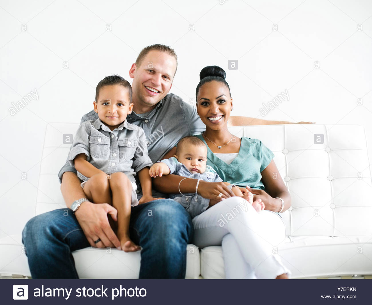 Portrait of family with two children (2-5 months, 2-3) - Stock Image