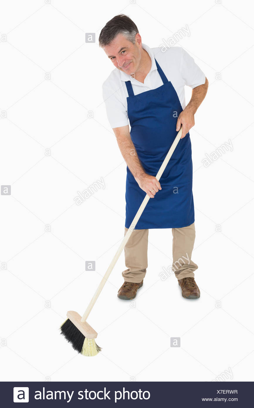 man sweeping floor high resolution stock photography and images alamy https www alamy com happy man sweeping floor image279994563 html