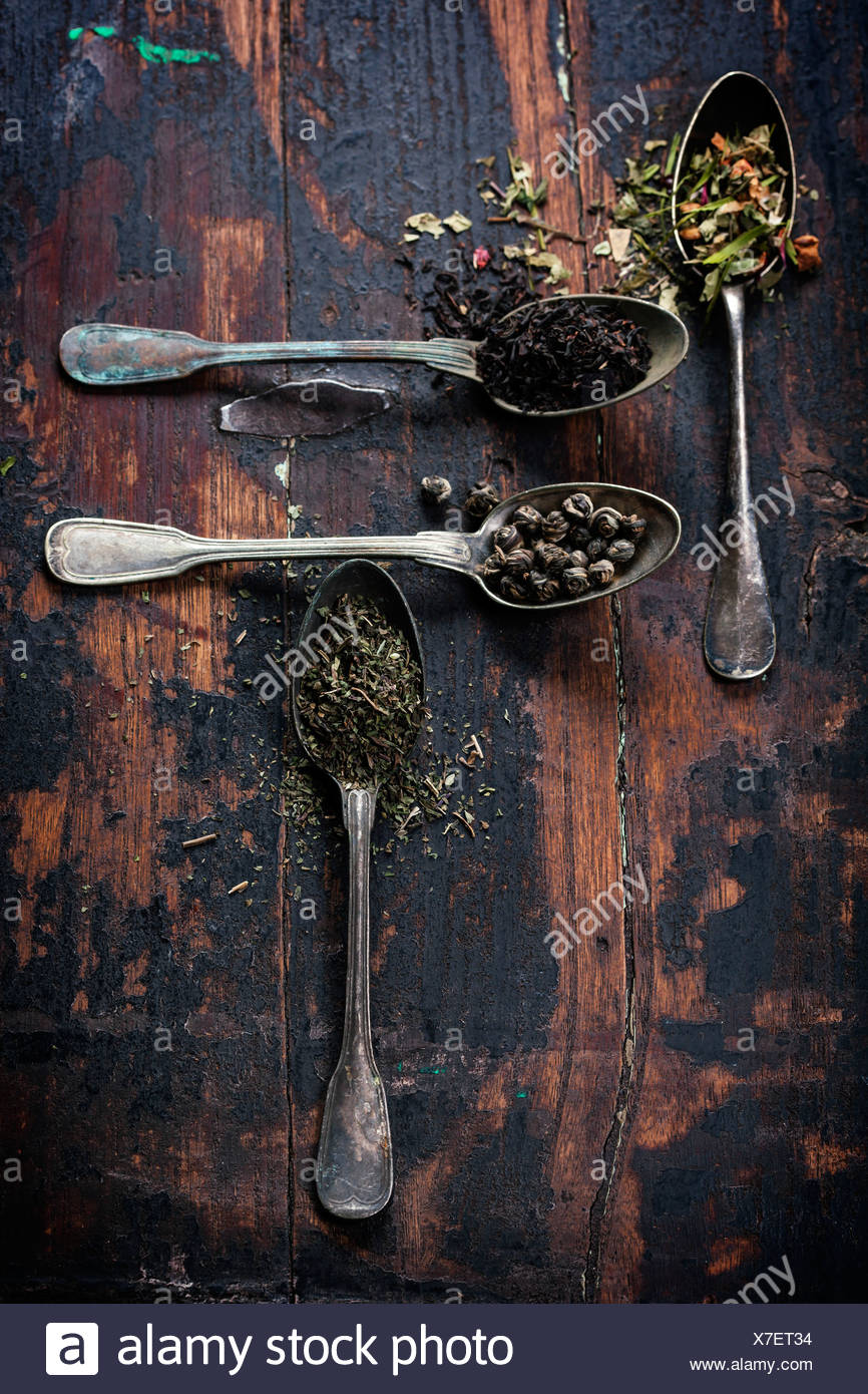 Various kinds of tea (black, green and herbal) on wooden background Stock Photo
