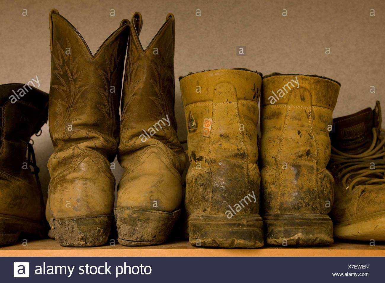 Oil Sands Works' Boots, Creeburn Lake Lodge, near Fort McKay, Alberta, Canada - Stock Image