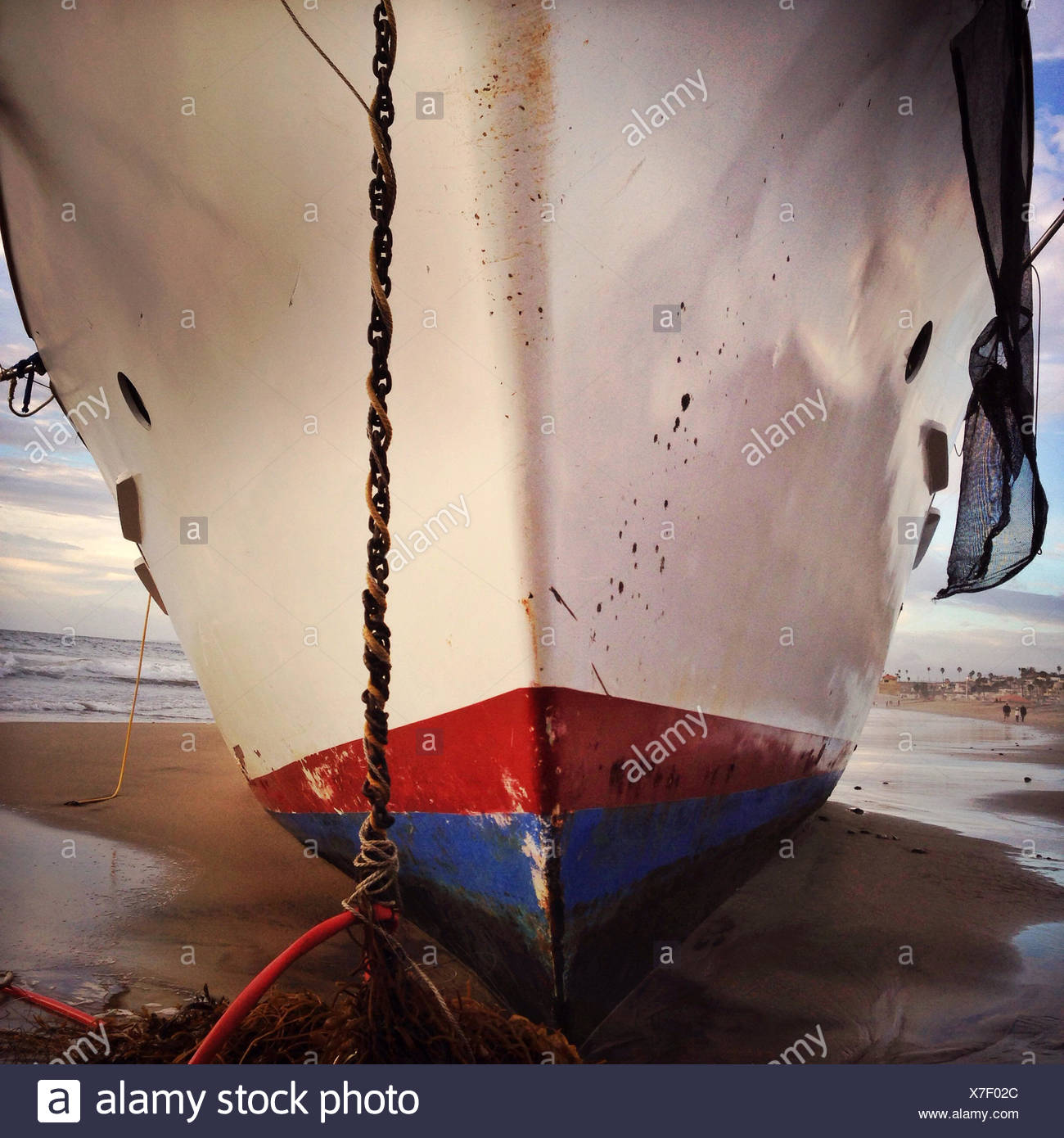 Close-up of bow of boat on beach - Stock Image