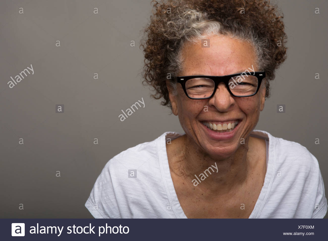 Studio portrait of happy senior woman - Stock Image