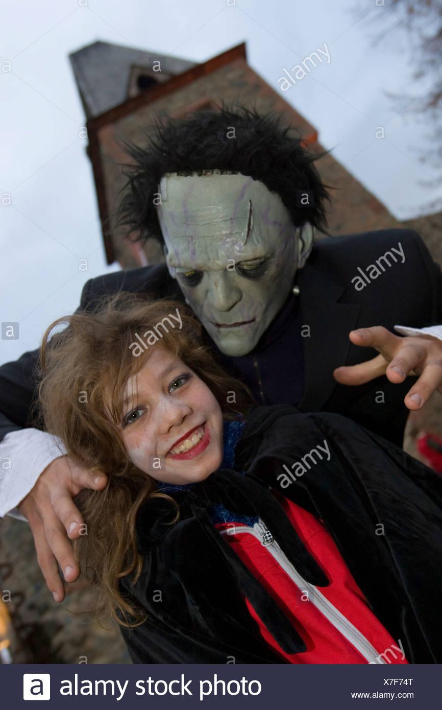 Traditional Halloween spectacle in the castle Frankenstein. A monster frightens a girl, castle Frankenstein, Hessen, Germany - Stock Image