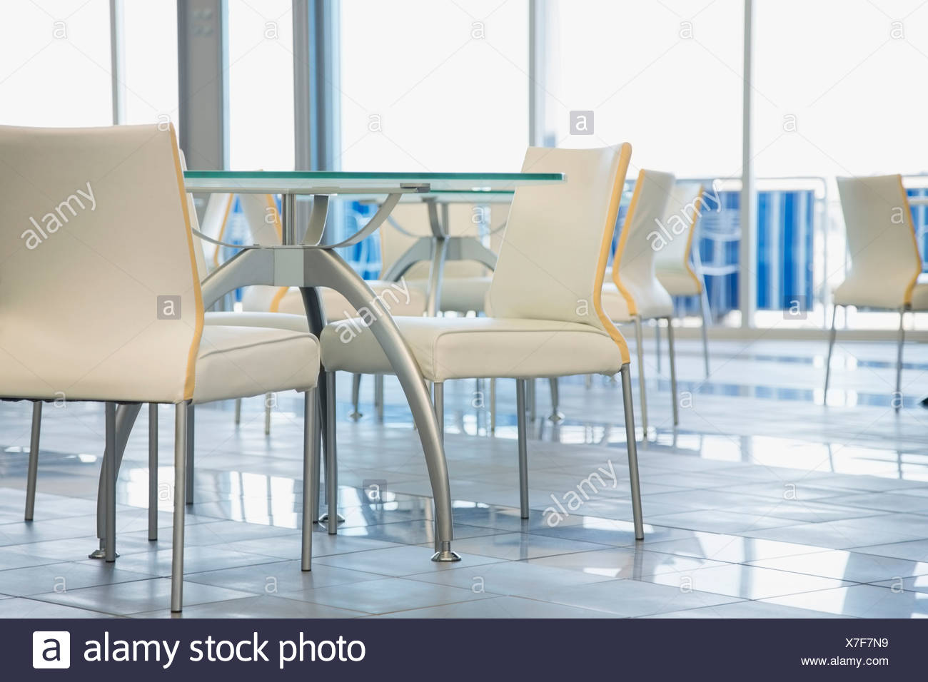 Tables and chairs in office cafeteria - Stock Image