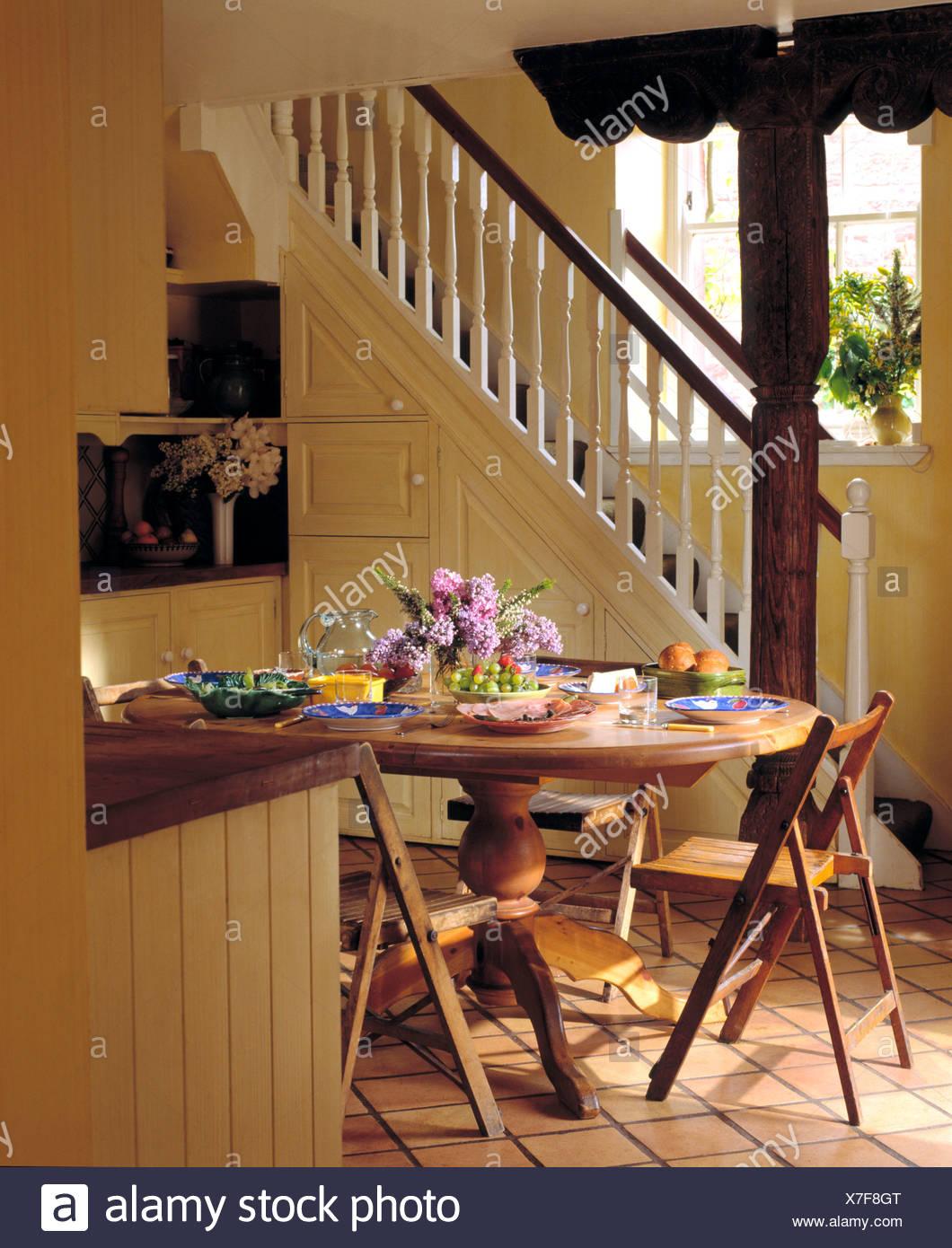 Remarkable Fresh Flower Arrangement On Circular Pedestal Table With Customarchery Wood Chair Design Ideas Customarcherynet