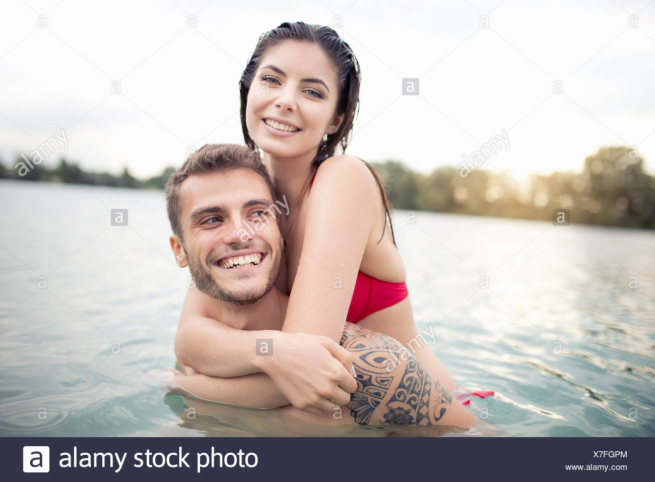 Attractive young couple hugging in lake Stock Photo