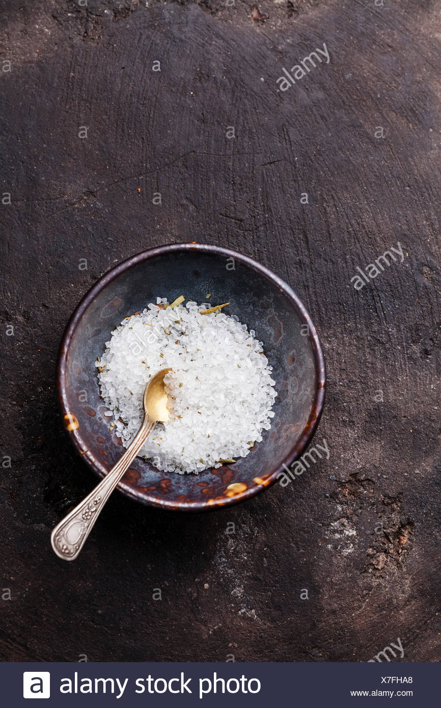 Food coarse Lemon Provencal salt on dark background - Stock Image