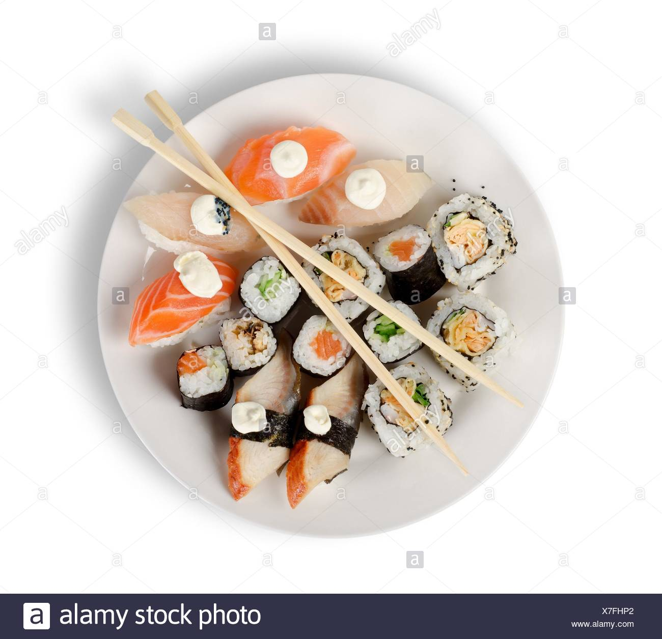 Sushi and rolls in a plate with sticks isolated on a white background. Clipping path. - Stock Image