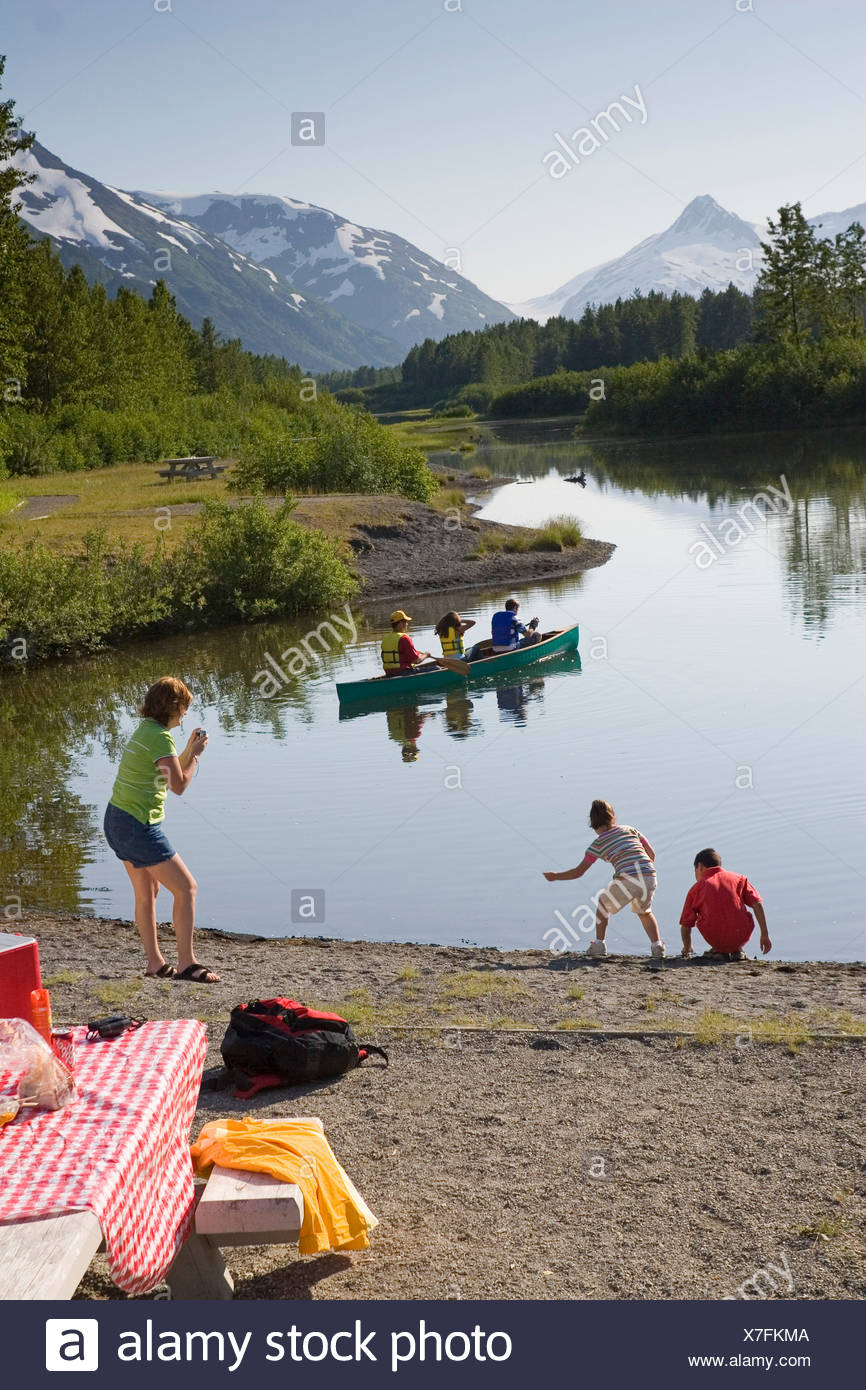 Family canoeing & picnicing @ Moose Flats day use area Portage Valley Chugach National Forest Alaska - Stock Image