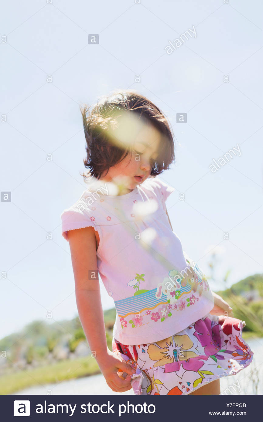 Girl standing pretty - Stock Image
