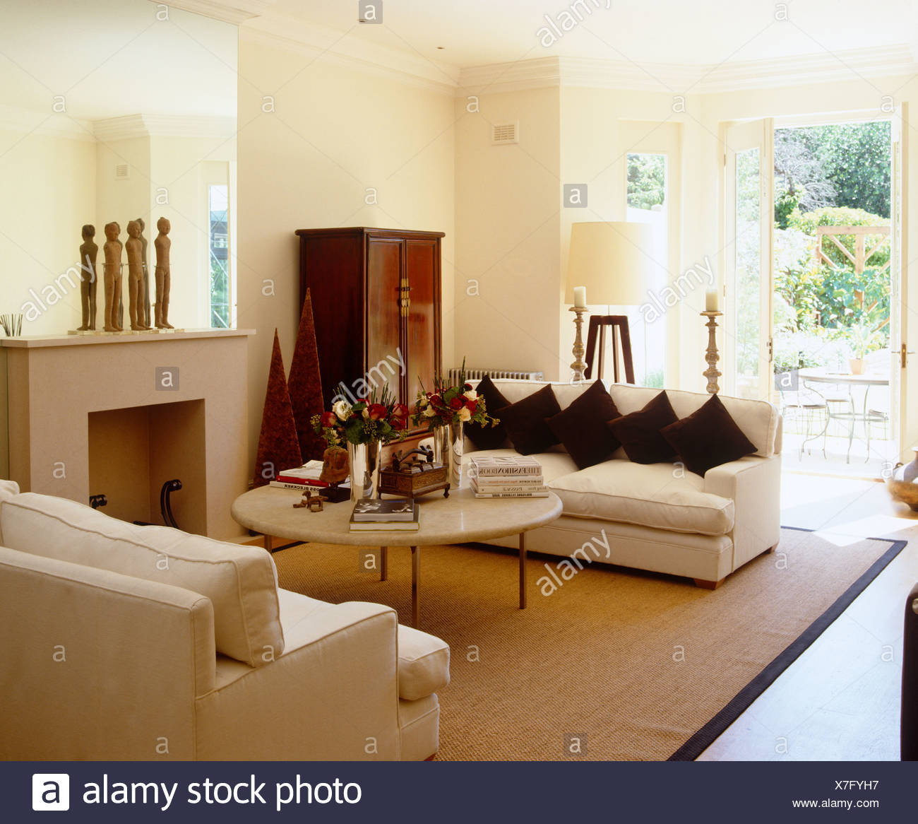 Cream Sofas Facing Each Other Over Coffee Table In Front Of