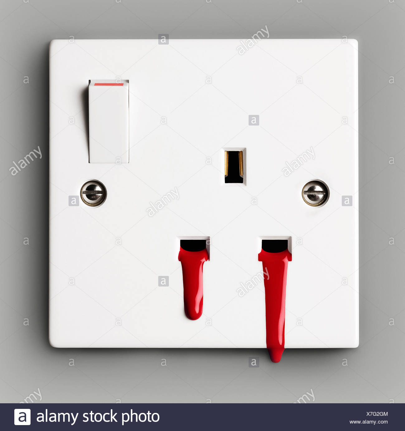 Blood coming out of electrical socket Stock Photo