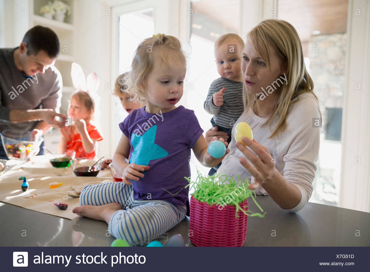 Mother and daughter with plastic Easter eggs - Stock Image