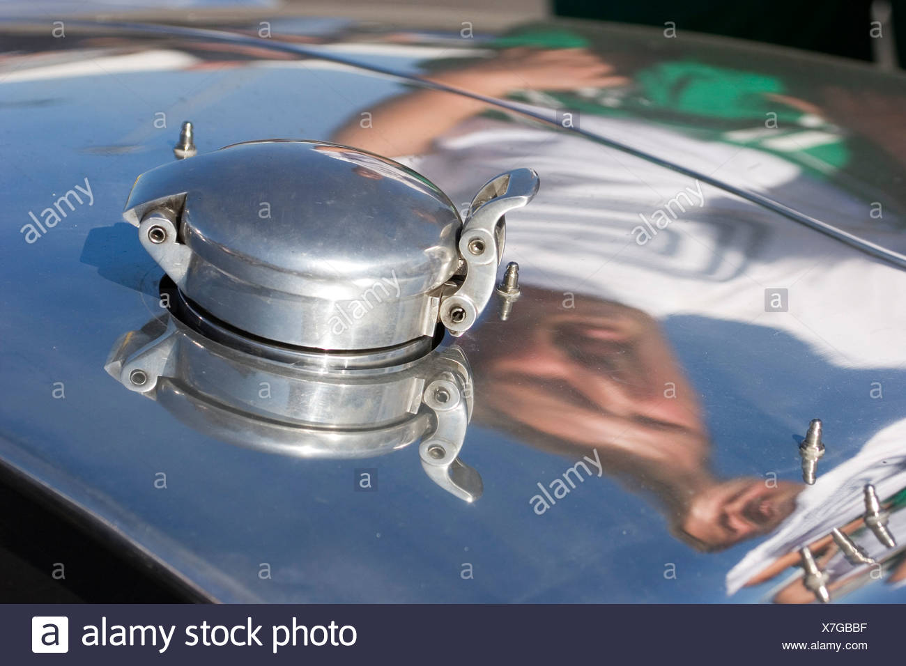 Gas cap of the AC Cobra 427, reflexion of the driver, Nuerburgring Classic 2007 - Stock Image