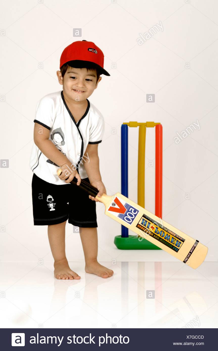 Indian Boy Playing Cricket ; Future Batsman ; MR - Stock Image