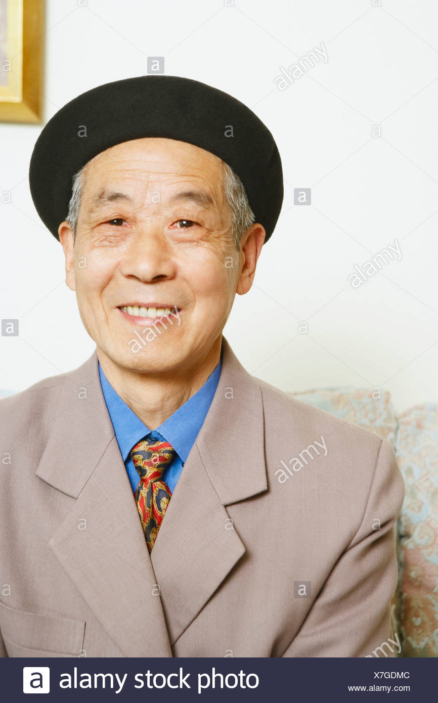Portrait of a senior man smiling - Stock Image