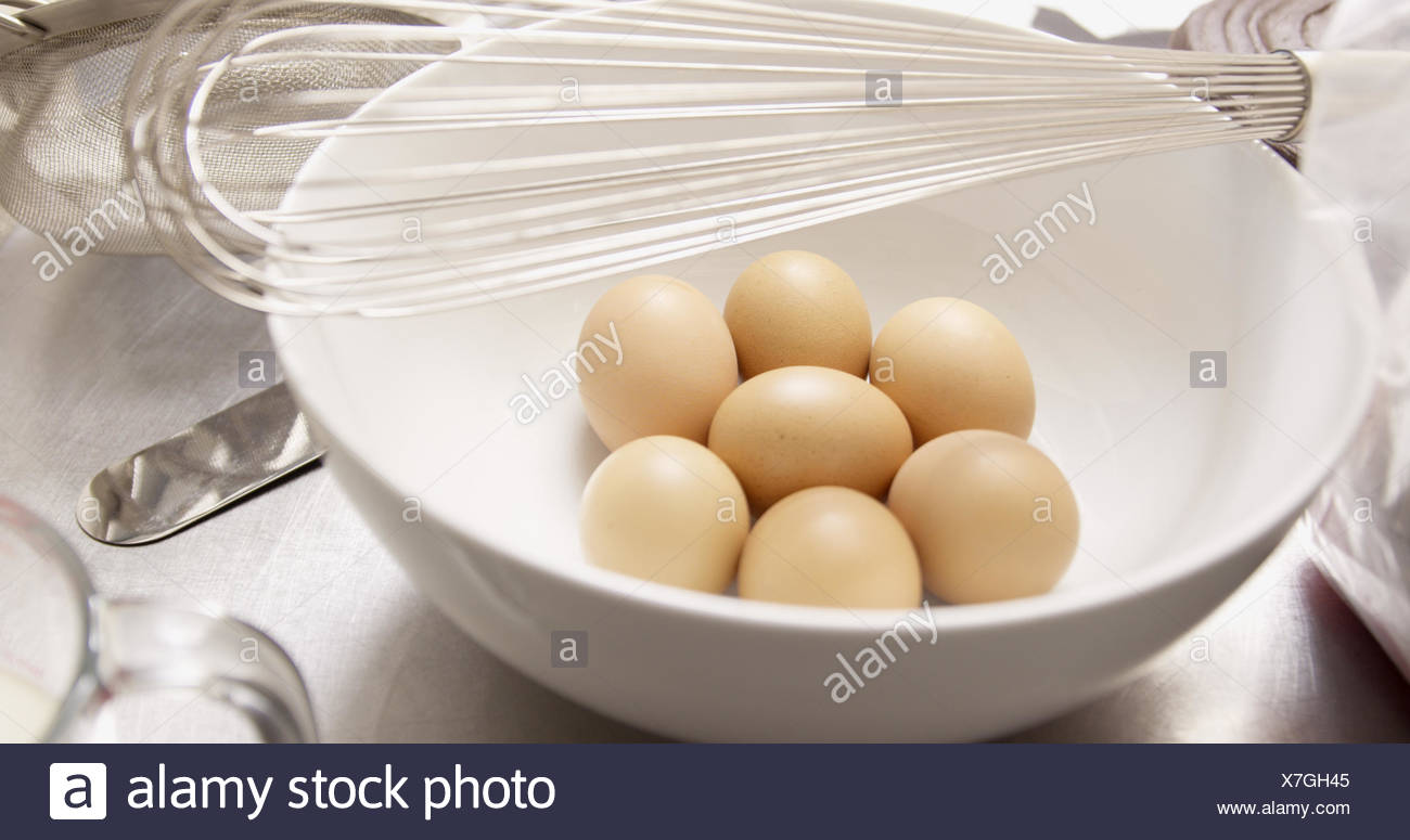 Focus on kitchen utensils with eggs - Stock Image