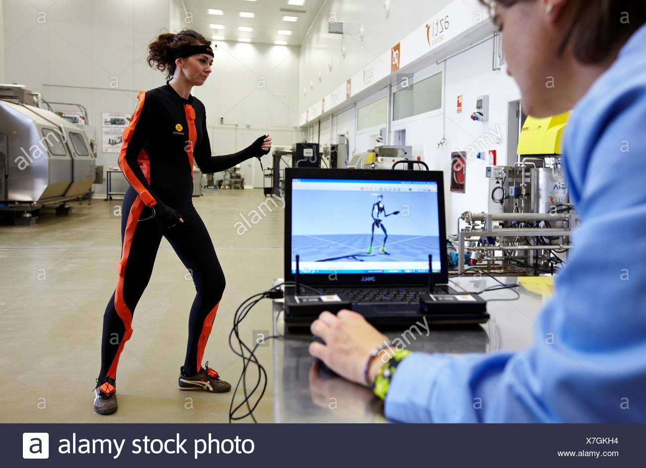 Researcher wearing a full body suit ´Ergomoven´ designed specifically for human motion capture, AZTI-Tecnalia Marine and Food - Stock Image