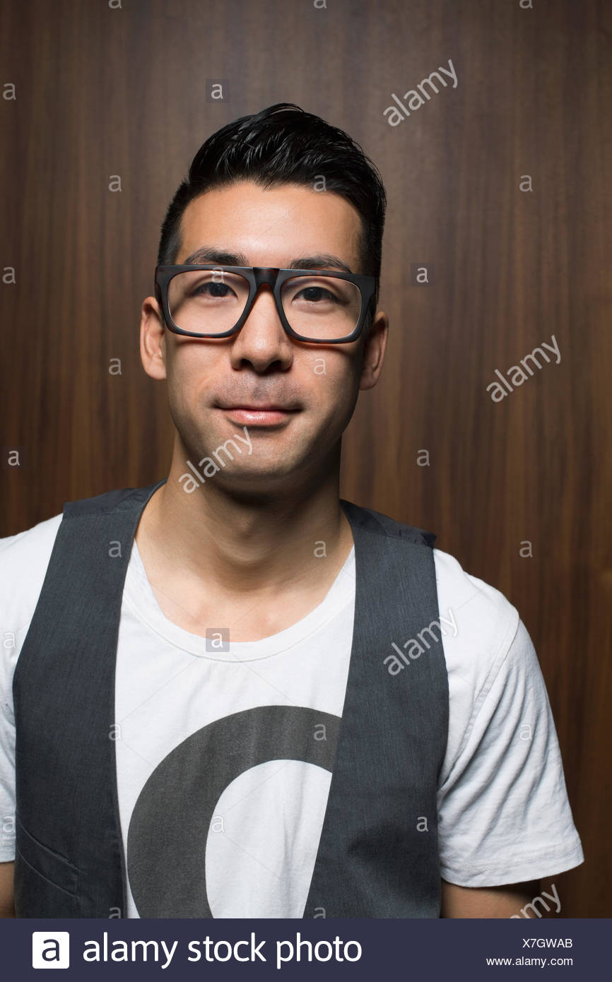Portrait of smiling man with eyeglasses - Stock Image
