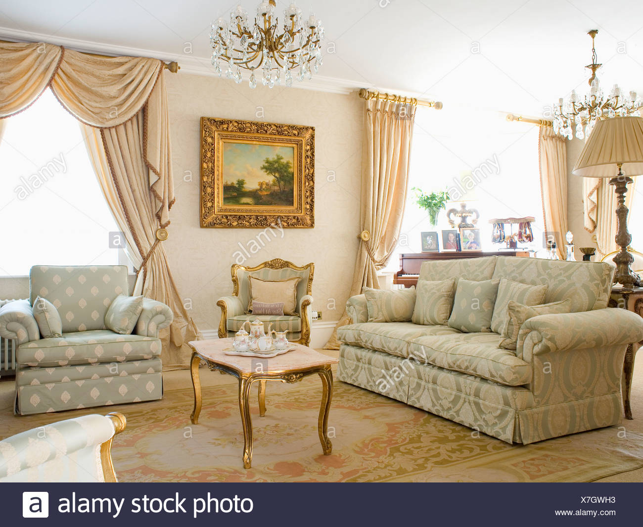 Opulent neutral country living room with damask sofa and patterned