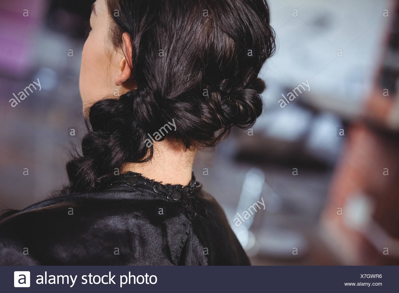Rear view of woman with braids hairstyle - Stock Image