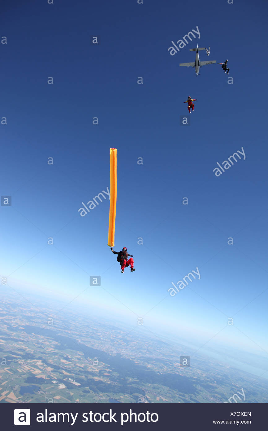 Skydivers free falling with air tube above Leutkirch, Bavaria, Germany - Stock Image