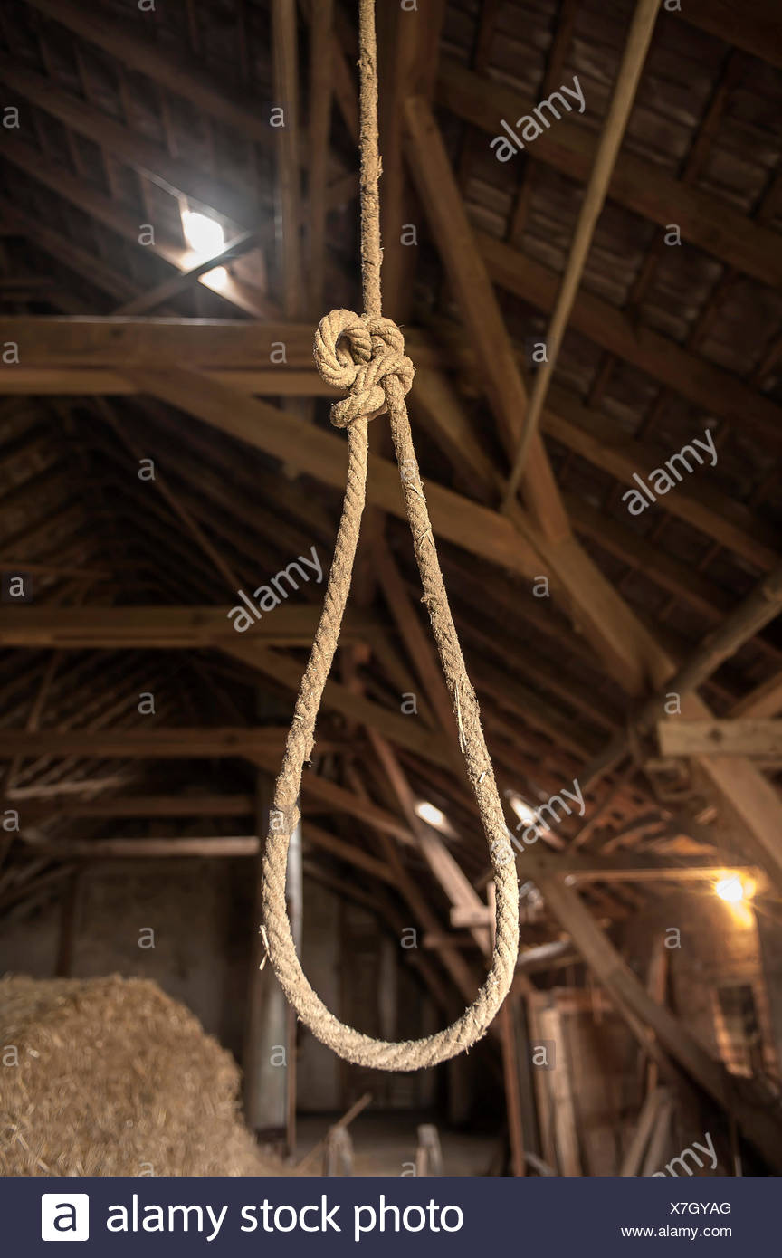 Rope with a noose in a hayloft - Stock Image