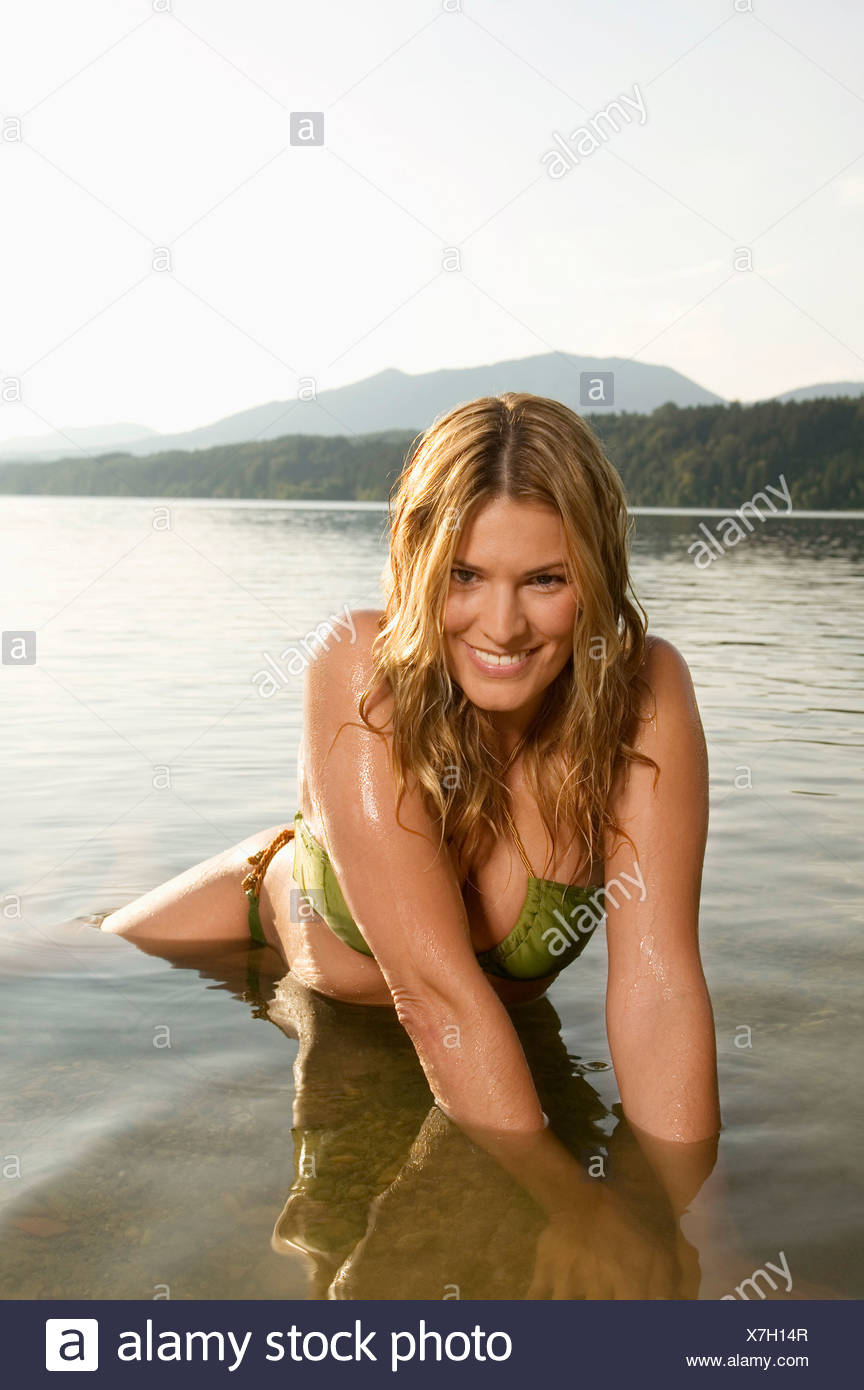 Woman bathing in lake Stock Photo